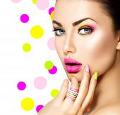 Beauty Girl Portrait with Colorful Makeup, Nail polish and ring Accessories. Colourful eyeshadows make-up. Studio Shot of Stylish Woman. Vivid Colors. Manicure and Hairstyle. Rainbow Colours  poster