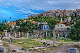 Athens, Greece - September,7 2014. Tourists Visiting The Ancient Agora At The Background Of The Acro