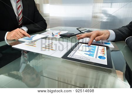 Two Businessman Working On Digital Tablet