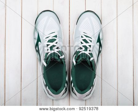 Sports Shoes On A White Wooden Background