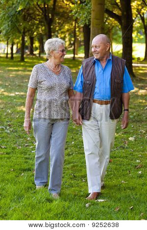 Mature Couple In Love Is Walking Seniors.