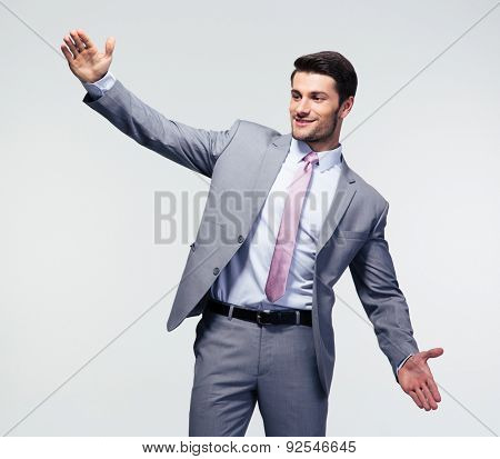 Businessman bragging about the size of something over gray background poster