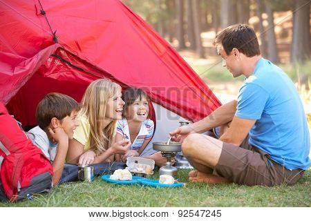 Family Cooking Breakfast On Camping Holiday