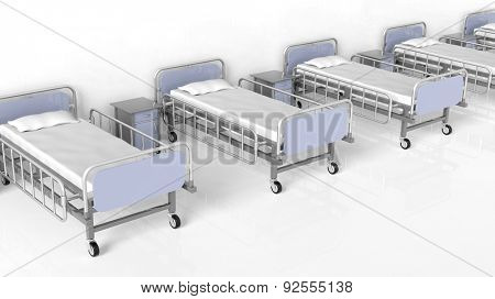 Hospital beds and bedside tables in a row