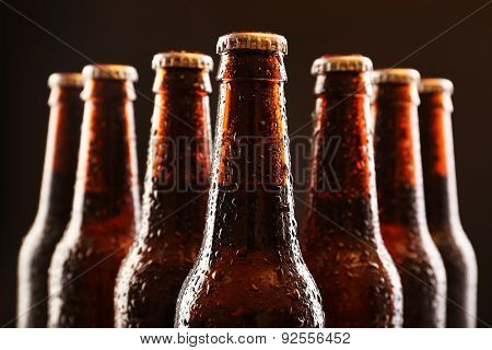 Glass bottles of beer on dark background
