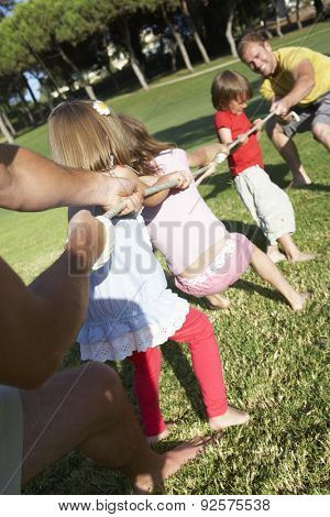 Fathers And Children Playing Tug Of War