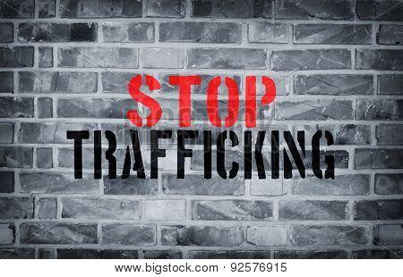 Stop Human Trafficking Stencil Print On The Grunge White Brick Wall