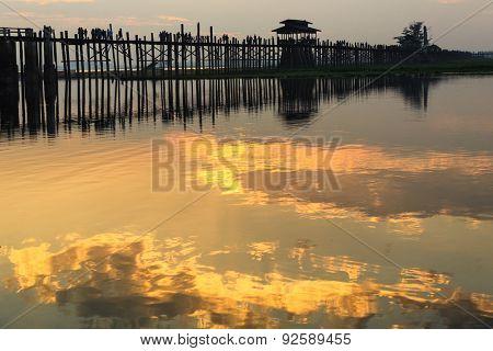 U bein wooden teck bridge at dusk in Myanmar