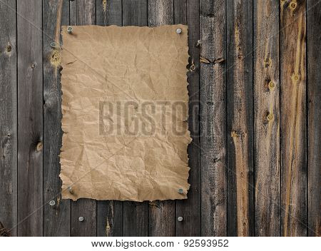 Empty Wanted Poster On Weathered Plank Wood Wall