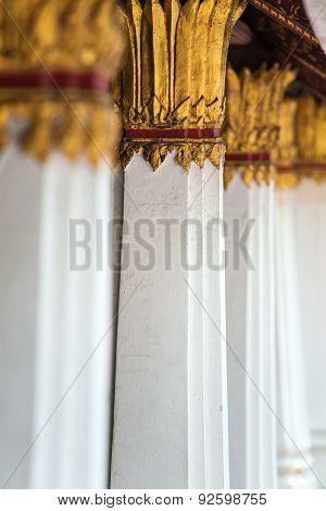 Columns Decorated With Gold Plated Ornament In Thai Temple