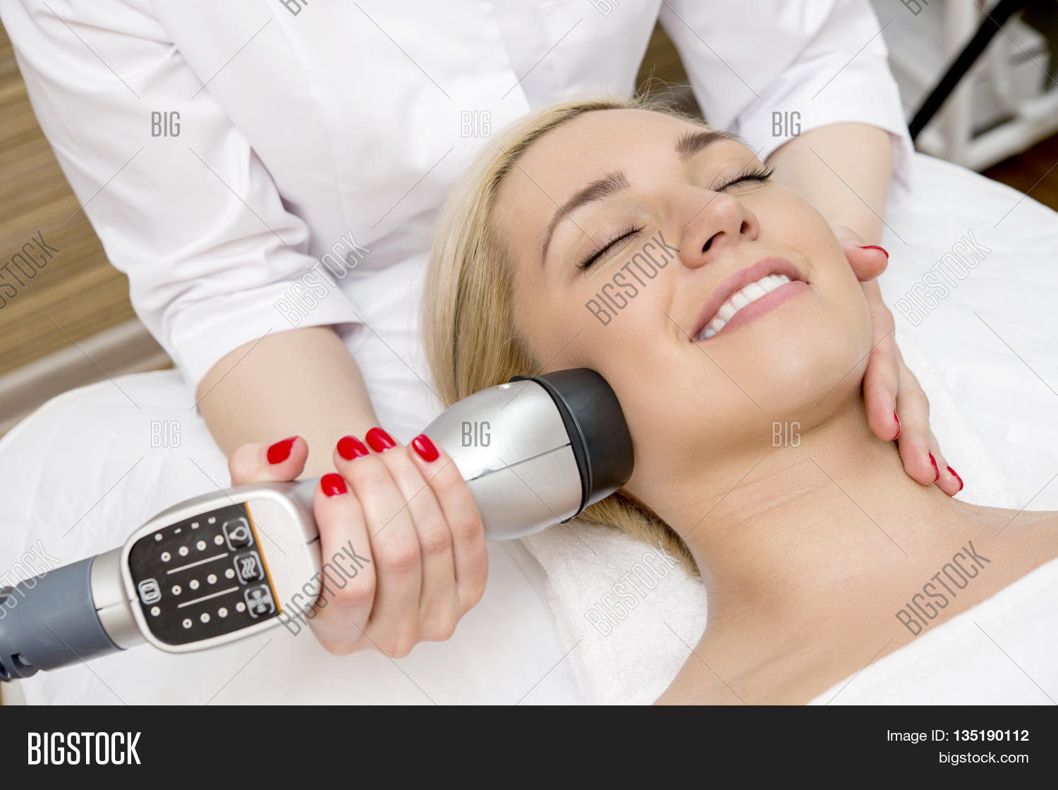 Female taking a facial massage in the spa salon