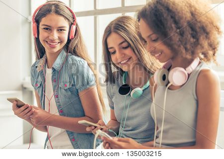 Attractive Teenage Girls With Gadgets