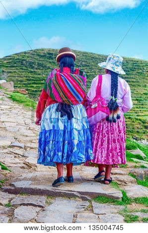 Island of the Sun Bolivia-March 22 2015: Bolivian women in traditional clothes on the street .