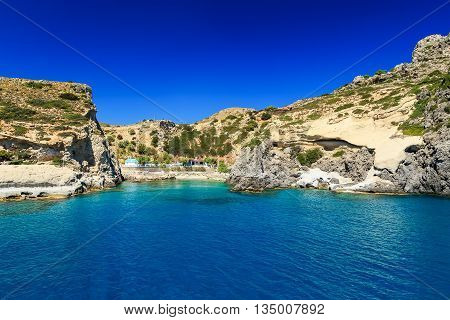 beautiful bay and rocks view from the sea Rhodes Greece sunny day