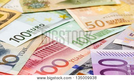 Word currency Yuan, US Dollar and Euro bank notes business background