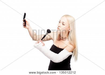 Girl With A Broken Arm Trying To Put Makeup