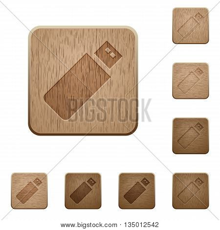 Set of carved wooden pendrive buttons in 8 variations.