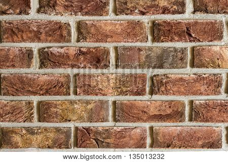 Vintage red Red brick wall fragment background texture. Close up