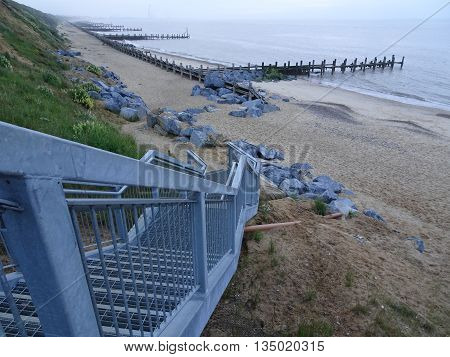 Steps leading to beach seascape photographed at Hopton On Sea in Norfolk