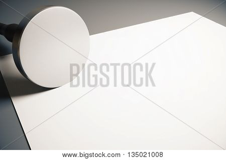 Round stamper and blank paper sheet on grey background. Mock up 3D Rendering