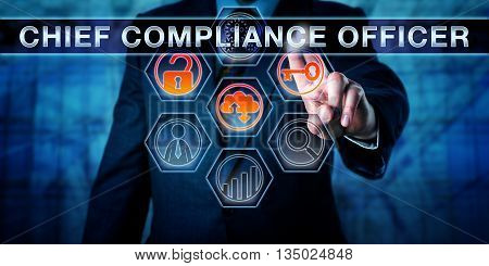 Business executive is pushing CHIEF COMPLIANCE OFFICER on an interactive touch screen interface. Business challenge metaphor for corporate governance regulatory compliance and corporate executives. poster