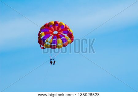 Couple Parasailing on a Beautiful Day in Mackinaw City