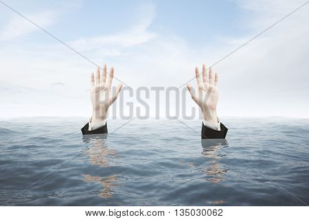 Businessman hands in water seeking rescue on sky background