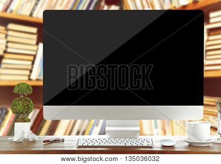 Modern computer on table in library. Law or school concept
