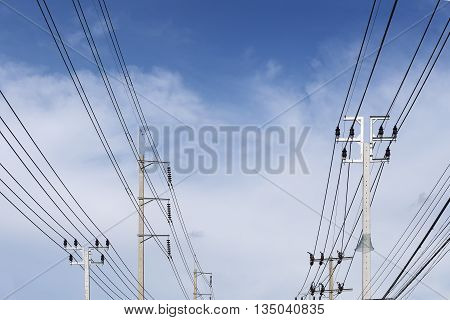 The electricity pole belong the street with the blue sky.The different type of electricity pole with the sky.The concrete electricity post belong the street with the blue sky.