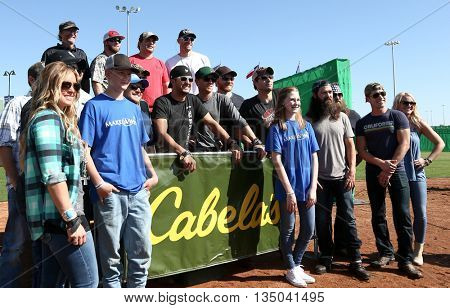 ARLINGTON, TX - APR 18: Participants at the ACM & Cabela's Great Outdoor Archery Event during the 50th Academy Of Country Music Awards at the Texas Rangers Youth Ballpark on April 18, 2015.