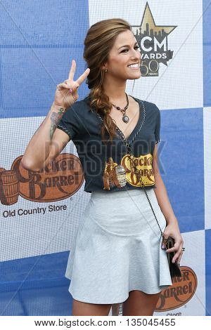 ARLINGTON, TX - APR 18: Singer Cassadee Pope attends the Cracker Barrel Old Country Store Country Checkers Challenge at Globe Life Park in Arlington on April 18, 2015 in Arlington, Texas.