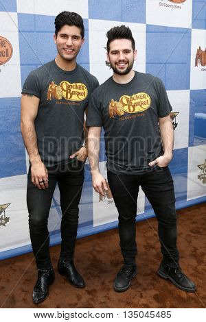 ARLINGTON, TX - APR 18:Dan Smyers (L) and Shay Mooney of Dan + Shay attend the Cracker Barrel Country Checkers Challenge at Globe Life Park in Arlington on April 18, 2015 in Arlington, Texas.