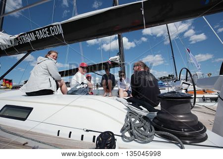 ST. PETERSBURG, RUSSIA - JUNE 4, 2016: British team on the yacht Petite Flamme in the day of the opening ceremony of the Nord Stream Race. Five teams compete in the race this year