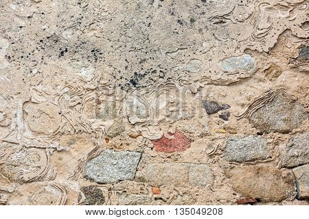 Stony wall close up as abstract background.