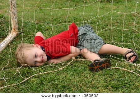 Toddler Boy Playing Goalie In Soccer Goal