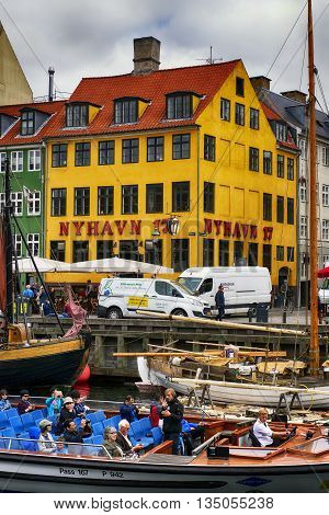 COPENHAGEN DENMARK - JUNE 8: Nyhavn street and canal in downtown of Copenhagen Denmark on June 8 2016.