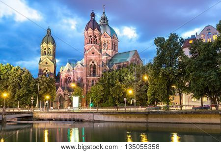 Lukaskirche St. Lukas pink church at dusk, Munich, Germany