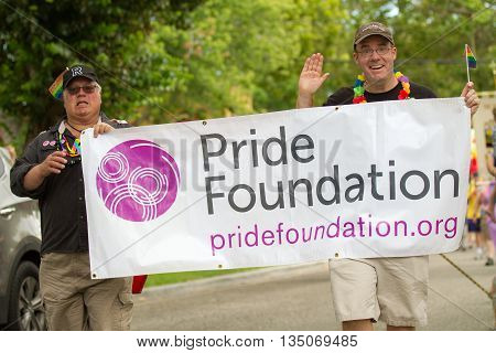 BOISE IDAHO/USA - JUNE 20 2016: Pride foundations banner during the parade at Boise Pridefest