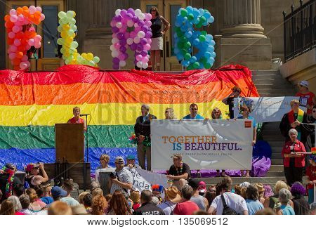 BOISE IDAHO/USA - JUNE 20 2016: Woman addressing the crowd at the Boise Pridefest
