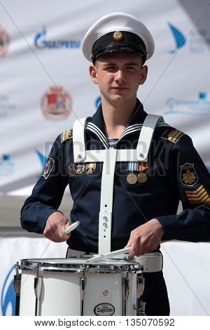 ST. PETERSBURG, RUSSIA - JUNE 4, 2016: Unidentified drummer from the band of Kronstadt naval cadet corps during the opening ceremony of the Nord Stream Race. Five teams compete in the race this year