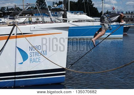 ST. PETERSBURG, RUSSIA - JUNE 4, 2016: Unidentified German athlete prepares the yacht SGM to the Nord Stream Race. Five teams on the Swan 60 yachts compete in the race this year