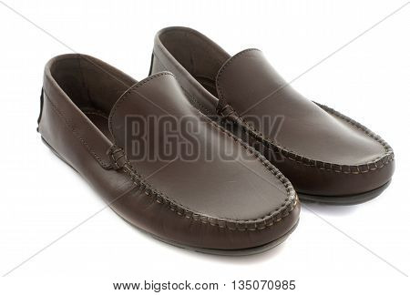 brown loafer in front of white background