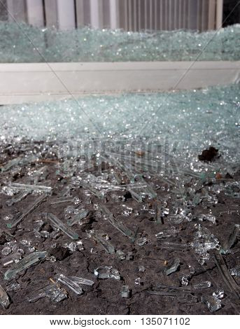 Sliding glass door that has been shattered after a home invasion
