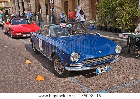MELDOLA FC ITALY - JUNE 12: vintage Fiat 124 Sport Spider at the start of the classic car rally