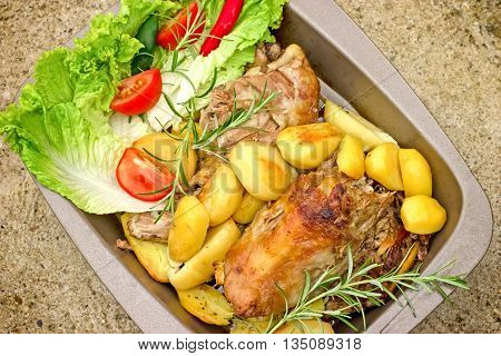 Delicious meal - roasted lamb with roasted potato and lettuce