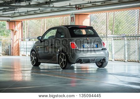 TriesteItaly June 182016:Photo of a Abarth 595 Competizione Cabrio.The 595 differs substantially from that Tourism for the aggressive appearance and a few deliberately exaggerating the sporty character.