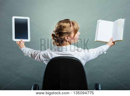 Woman Holding Traditional Book And E-book Reader