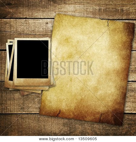 vintage paper and photo on wood background