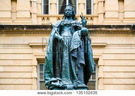 Bronze Queen Victoria statue in front of popular hotel building,  Brisbane