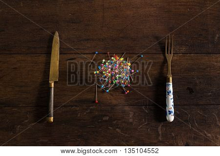 Pins as a meal, on wooden table